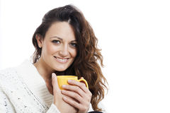 Young beautiful woman with cup in bed Royalty Free Stock Photo