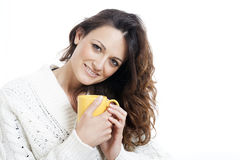 Young beautiful woman with cup in bed Royalty Free Stock Images