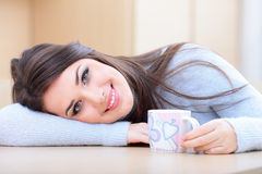 Young beautiful woman with cup at home Stock Photography