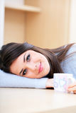 Young beautiful woman with cup at home Stock Photos