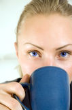 Young beautiful woman with cup of tea Stock Images
