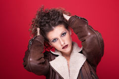 Young and beautiful woman, with curly hair, on red Royalty Free Stock Photo