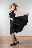 Young beautiful woman is dancing. Royalty Free Stock Image