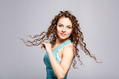Young beautiful woman dancing against grey wall Royalty Free Stock Image