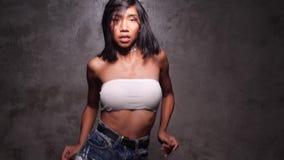 Attractive hip hop dancer in studio
