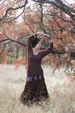 Young beautiful woman dancing outdoors Stock Photos