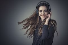 She`s listening to her favorite music Royalty Free Stock Photos