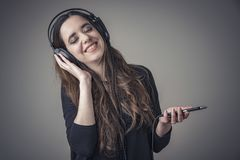 She`s listening to her favorite music Stock Images