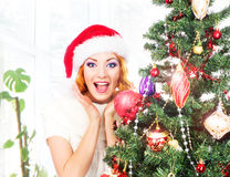 Young and beautiful woman decorating Christmas tree Stock Photos