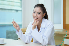 Young beautiful woman dentist holding dental tools Stock Photo