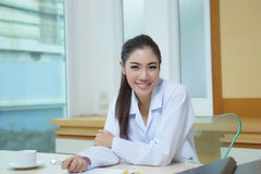 Young beautiful woman dentist holding dental tools Royalty Free Stock Photos