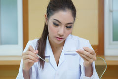 Young beautiful woman dentist holding dental tools Stock Photography
