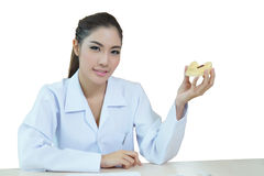 Young beautiful woman dentist holding denture cast model Royalty Free Stock Images
