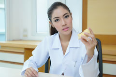 Young beautiful woman dentist holding denture cast model Royalty Free Stock Photography