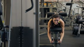 Young beautiful woman do exercise on Hamstrings in fitness club. stock video footage