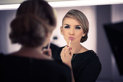 Young beautiful woman does a house make up Royalty Free Stock Image