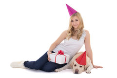 Young beautiful woman and dog in birthday hats isolated on white Stock Photos