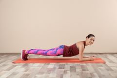 Young beautiful woman doing exercise at home stock photography