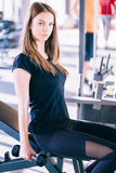 Young beautiful woman doing exercises with dumbbell in gym Royalty Free Stock Photography