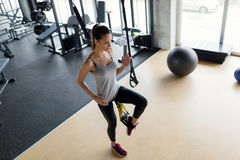 Young beautiful woman doing exercises in gym. Young beautiful woman doing exercises for legs in gym Stock Images