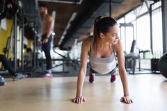 Young beautiful woman doing exercises in gym Royalty Free Stock Images