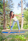 Young beautiful woman doing  exercises in the park Royalty Free Stock Photo