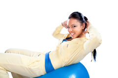 Young beautiful woman doing fitness on the ball stock photos