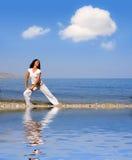 Young beautiful woman doing fitness exercises Stock Photos