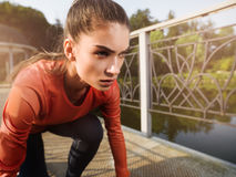 Young beautiful woman doing fitness in a park. Stock Photos