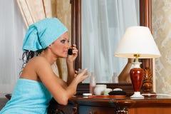 Young  beautiful woman doing makeup. Royalty Free Stock Photography