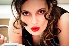 Young beautiful woman doing makeup Royalty Free Stock Photos
