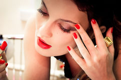 Young beautiful woman doing makeup Royalty Free Stock Photos