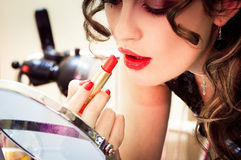 Young beautiful woman doing makeup Royalty Free Stock Image