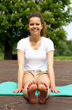Young beautiful woman doing meditation in park. Stock Photography