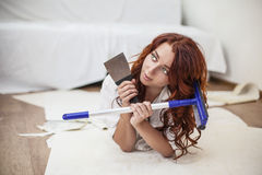 Young beautiful woman doing repairs in the house with tools Stock Image
