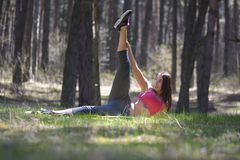 Young beautiful woman doing stretching exercise Stock Images