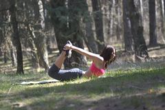 Young beautiful woman doing stretching exercise Stock Photography