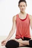 Young beautiful woman doing yoga Stock Photos