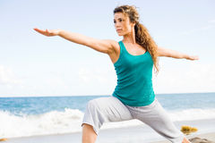 Young Beautiful Woman Doing Yoga On The Beach Royalty Free Stock Photos