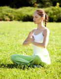 Young and beautiful woman doing yoga exercises Stock Photo