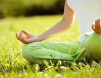 Young and beautiful woman doing yoga exercises .Yoga background Royalty Free Stock Photos