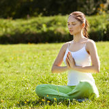 Young and beautiful woman doing yoga exercises .Yoga background Stock Photo