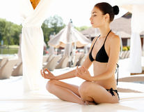 Young and Beautiful Woman Doing Yoga Exercises . Yoga Background Stock Images