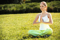 Young and beautiful woman doing yoga exercises .Yoga background Royalty Free Stock Photo