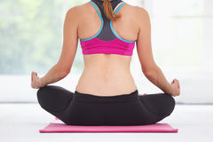 Young beautiful woman doing yoga. Royalty Free Stock Images