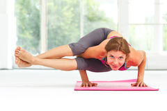 Young beautiful woman doing yoga. Royalty Free Stock Image