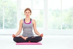 Young beautiful woman doing yoga. Stock Image