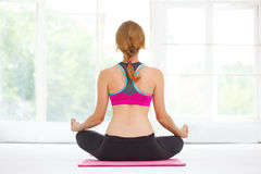 Young beautiful woman doing yoga. Royalty Free Stock Photos