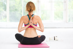 Young beautiful woman doing yoga. stock photo