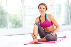 Young beautiful woman doing yoga. Stock Photography